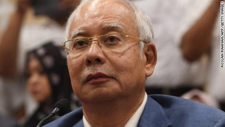 Former Malaysian prime minister Najib Razak announces his resignation as president of the United Malays National Organisation on May 12.
