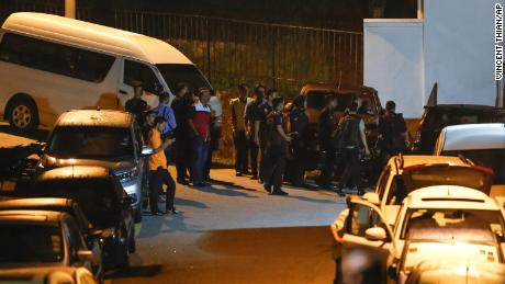 Police gather at the residence of former Prime Minister Najib Razak in Kuala Lumpur on Wednesday.