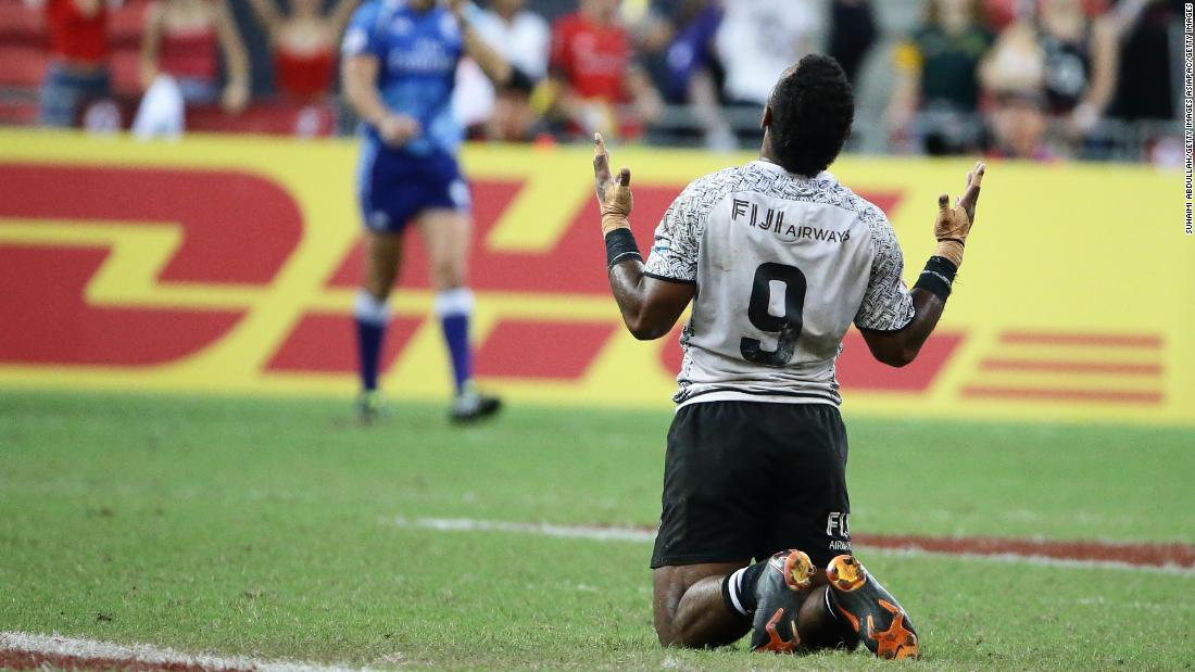 Jerry Tuwai sinks to his knees after his Fiji side scored a try in the last play of the game to win the Singapore Sevens title over Australia in April.