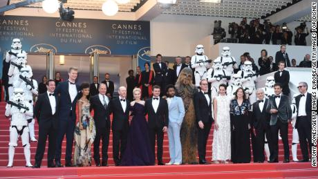 CANNES, FRANCE - MAY 15:  (L-R)  Producer Simon Emanuel, actor Joonas Suotamo, actress Thandie Newton, actor Woody Harrelson, director Ron Howard, actress Emilia Clarke, actor Alden Ehrenreich, actor Donald Glover, Chewbacca, Paul Bettany and Phoebe Waller-Bridge and members of the cast, attend the European Premiere of 'Solo: A Star Wars Story' at Palais des Festivals on May 15, 2018 in Cannes, France.  (Photo by Antony Jones/Getty Images for Disney)
