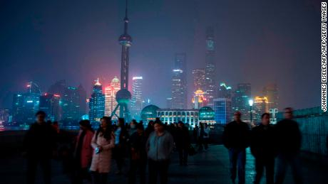 The skyline of the Lujiazui Financial District in Pudong, Shanghai with its lights turned off for the Earth Hour environmental campaign on March 25, 2017. / AFP PHOTO / Johannes EISELE        (Photo credit should read JOHANNES EISELE/AFP/Getty Images)
