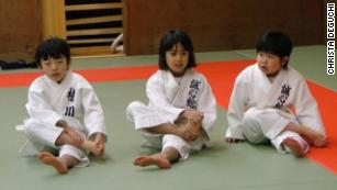 Deguchi warming up in the dojo growing up in Japan.