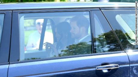 Prince Harry and Meghan Markle arrive at Windsor Castle for wedding rehearsals Thursday.