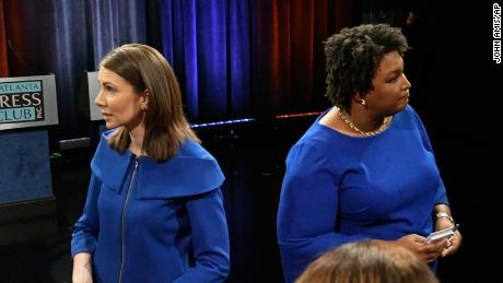 Georgia Democratic gubernatorial candidates and former state representatives, Stacey Evans, left, and Stacey Abrams talk to moderators after debating Tuesday, May 15, 2018, in Atlanta. (AP Photo/John Amis)