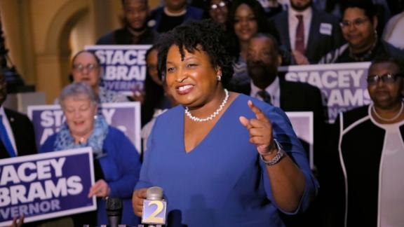 FILE - In this Tuesday, March 6, 2018 file photo, Stacey Abrams holds a news conference in Atlanta to announce she has qualified to run for governor. The record number of women expected to run for office in 2018 are already breaking barriers, upending traditional campaigning as they look to introduce themselves to an electorate they hope is eager for change. (Bob Andres/Atlanta Journal-Constitution via AP)