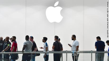 Customers stand in line to purchase the new Apple iPhone 8 at Dubai Mall Apple Store in Dubai, on September 23, 2017. The new Apple iPhone 8 and 8 Plus, as well as the updated Apple Watch and Apple TV, went on sale today. / AFP PHOTO / GIUSEPPE CACACE        (Photo credit should read GIUSEPPE CACACE/AFP/Getty Images)
