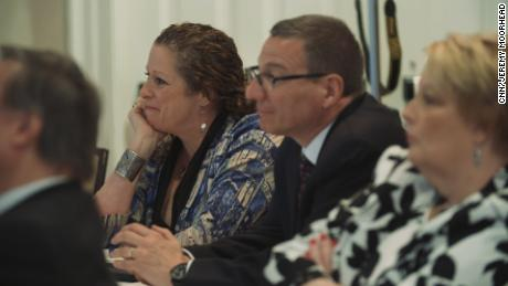 "Abigail Disney and Rob Schenck listen to a panel discussing gun violence at the event ""The Gospel and a Sidewarm,"" hosted by the Dietrich Bonhoeffer Institute."