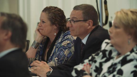 """Abigail Disney and Rob Schenck listen to a panel discussing gun violence at the event """"The Gospel and a Sidewarm,"""" hosted by the Dietrich Bonhoeffer Institute."""