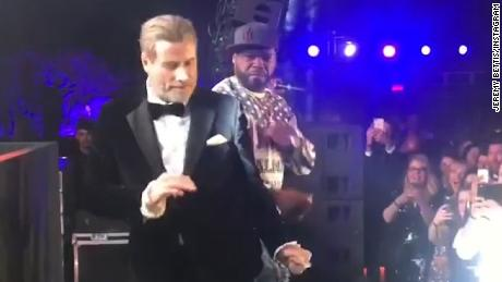john travolta dances with 50 cent at cannes_00003022