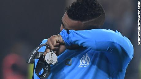 Dimtri Payet cries after Marseille's 3-0 Europa League final defeat to Atletico Madrid.