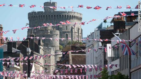 Union flags are displayed in the street in front of Windsor Castle ahead of the royal wedding.