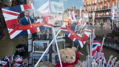 A shop close to Windsor Castle displays royal memorabilia in the window.