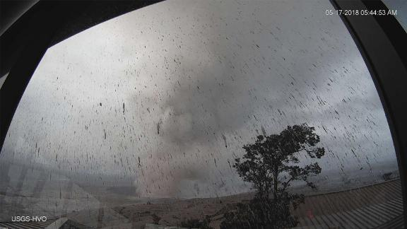 A webcam from a Hawaiian Volcano Observatory tower captures the plume rising into the sky.