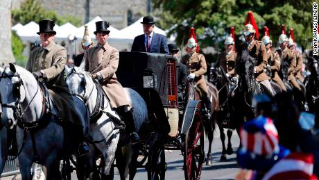 Mounted members of the Household Cavalry escort the carriage through Windsor in the parade rehearsal.