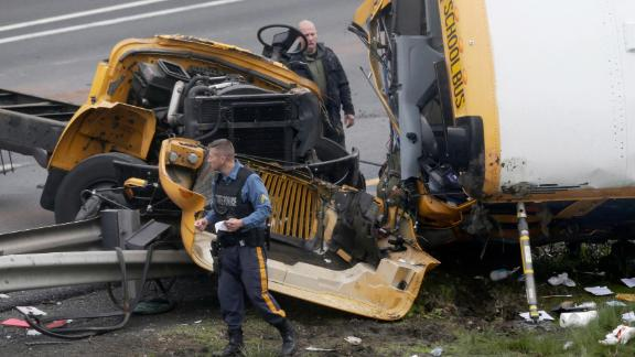 Emergency personnel work at the scene of a school bus and dump truck collision on Interstate 80 on May 17.
