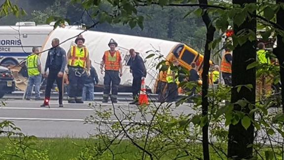 Emergency crews evaluate the scene of a school bus crash in Mount Olive Township, New Jersey, on May 17.