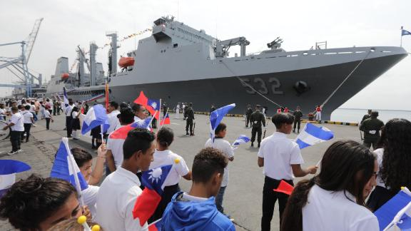 Nicaraguan students wave Taiwanese flags to welcome three Taiwanese Navy warships at Corinto port, some 149 kilometers northwest of Managua, on April 9, 2018. Nicaragua is one Taiwan's few diplomatic allies.