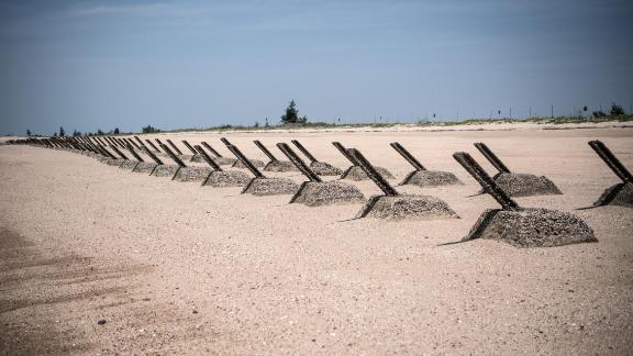 Aged anti-landing barricades are positioned on a beach facing China on the Taiwanese island of Kinmen which, at points lies only a few miles from China.