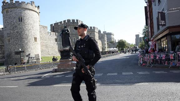 Armed police take position ahead of the dress rehearsal for the wedding on May 17.