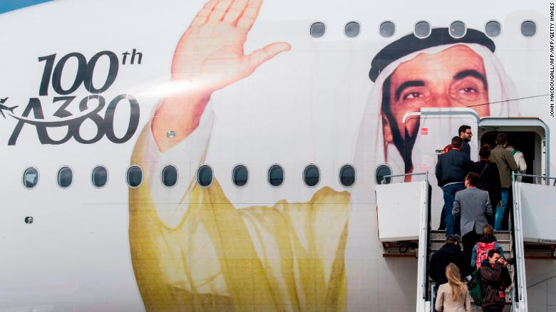 Visitors board an Emirates A380 Airbus passenger aircraft decorated with a giant portrait of UAE founding father Zayed bin Sultan Al Nahyan, to celebrate the centenary of his birth, at the ILA Berlin International Aerospace Exhibition at Schoenefeld airport near Berlin on April 25, 2018. - According to the organisers, over 1,000 exhibitors will showcase their expertise  from civil aviation to defense, security and space, and from major corporations to highly specialized suppliers. The fair is running from April 25 to 29, 2018. (Photo by John MACDOUGALL / AFP)        (Photo credit should read JOHN MACDOUGALL/AFP/Getty Images)