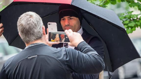 Lawyer Aaron Schlossberg, center, the man who ranted against the people speaking Spanish in a Midtown restaurant, takes a cellphone video of reporters taking his video as he leaves his home in Manhattan, New York on Thursday, May 17, 2018. (Photo by Anthony DelMundo/NY Daily News via Getty Images)