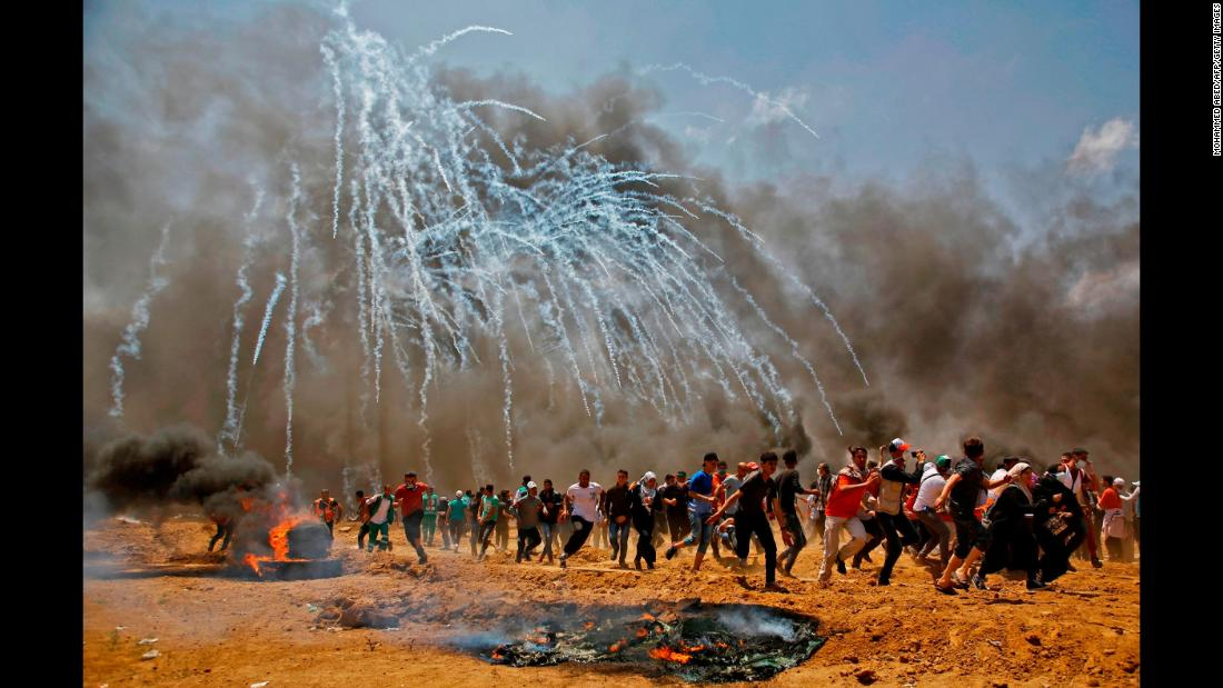 "Tear gas rains down on Palestinians near the Israeli-Gaza border on Monday, May 14. According to the Palestinian Health Ministry, <a href=""https://www.cnn.com/2018/05/14/middleeast/gaza-protests-intl/index.html"" target=""_blank"">dozens of Palestinians were killed by Israeli forces </a>during protests over the new US Embassy in Jerusalem. Palestinian officials accused Israel of committing a ""horrific massacre"" and called on the international community to intervene. Israeli Prime Minister Benjamin Netanyahu defended his military's actions, tweeting that ""every country has the duty to defend its borders."" Israel's military said protesters threw Molotov cocktails, stones and burned tires at Israeli soldiers positioned along the fence separating Israel and Gaza."