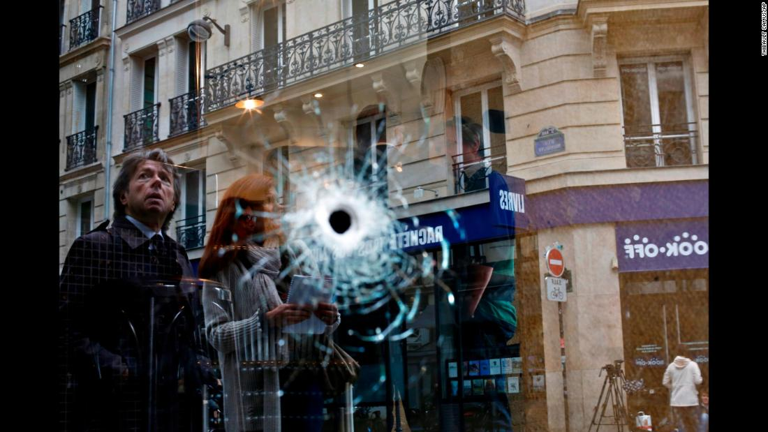 "A bullet hole is seen on a cafe window in Paris on Sunday, May 13. The cafe was near the area where a knife-wielding attacker <a href=""https://www.cnn.com/2018/05/13/europe/paris-stabbing-chechnya-attacker-intl/index.html"" target=""_blank"">stabbed five people,</a> killing one of them, before being fatally shot by police. ISIS claimed responsibility for the attack."