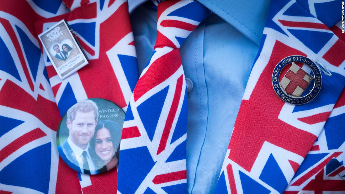 "Britain's Prince Harry and his fiancee, Meghan Markle, are seen on a person's clothes in Windsor, England, on Thursday, May 17. People are already camping out in Windsor so they can catch a glimpse of the couple on <a href=""https://www.cnn.com/2018/04/04/europe/royal-wedding-what-we-know-intl/index.html"" target=""_blank"">their wedding day.</a>"