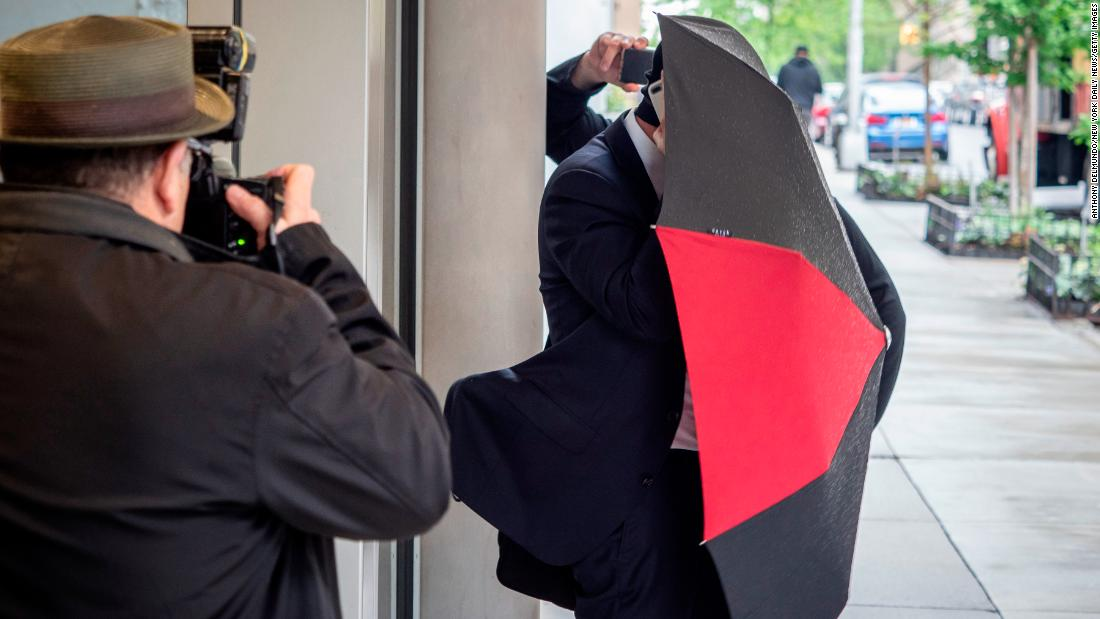 "Aaron Schlossberg, the attorney who berated employees and customers for speaking Spanish in a New York restaurant, covers himself with an umbrella as he leaves his home in Manhattan on Thursday, May 17. <a href=""https://www.cnn.com/2018/05/17/us/new-york-man-restaurant-ice-threat/index.html"" target=""_blank"">The restaurant encounter </a>happened Tuesday, according to Edward Suazo, who posted a video of it on Facebook. The video had been viewed 4.4 million times by early Thursday."