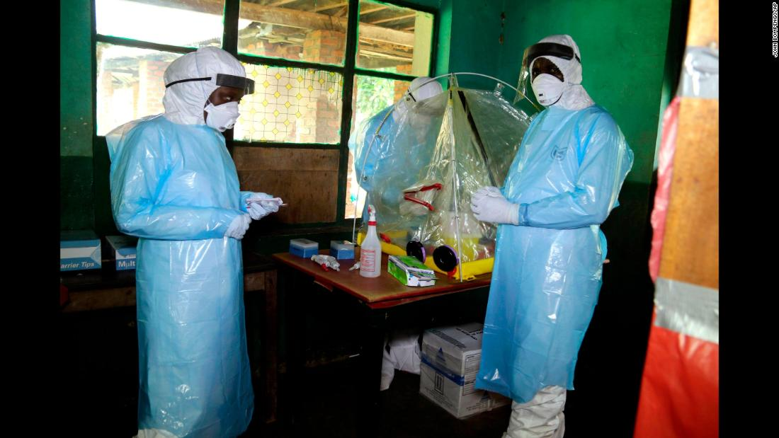"Health care workers wear protective gear at a treatment center in Bikoro, Congo, on Sunday, May 13. An Ebola outbreak was announced in the rural area last week, <a href=""https://www.cnn.com/2018/05/17/health/ebola-outbreak-mbandaka-drc-intl/index.html"" target=""_blank"">but it has since spread to Mbandaka,</a> a city of nearly 1.2 million people."