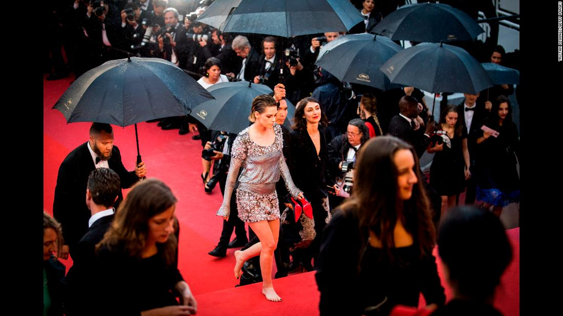 Actress Kristen Stewart walks barefoot during a red-carpet event at the Cannes Film Festival on Monday, May 14.