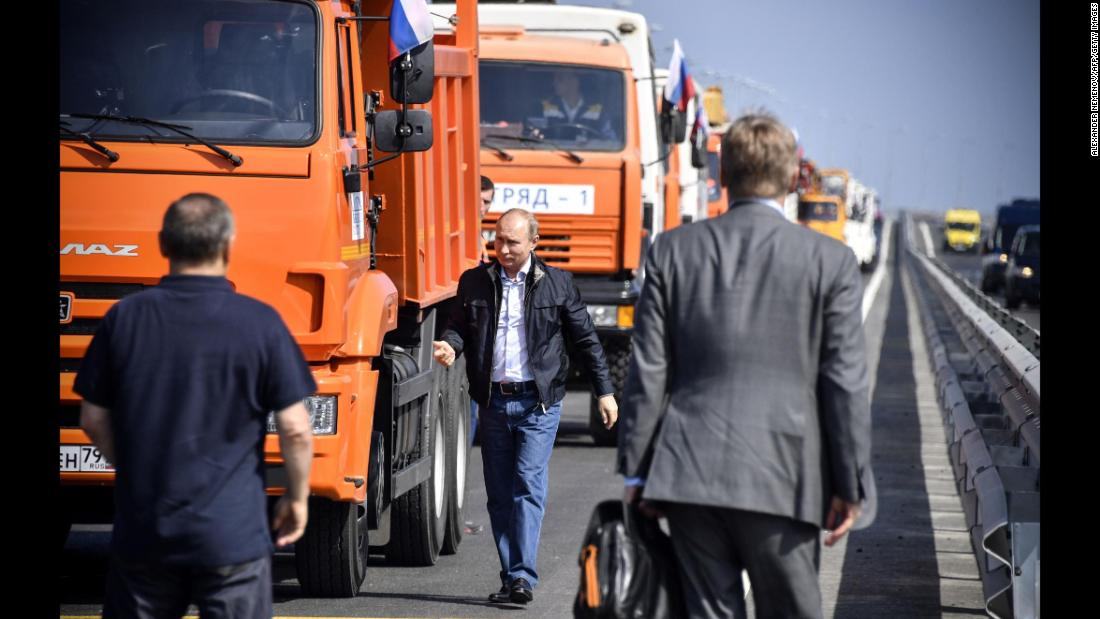"Russian President Vladimir Putin walks away from a construction truck after he drove the vehicle across<a href=""https://www.cnn.com/2018/05/15/europe/russia-crimea-bridge-intl/index.html"" target=""_blank""> the new Kerch Strait bridge</a> on Tuesday, May 15. The 19-kilometer (11.8-mile) bridge is now the longest in Europe, and it links Russia's Krasnodar region with the Crimean peninsula, which was annexed by Russia from Ukraine in 2014."