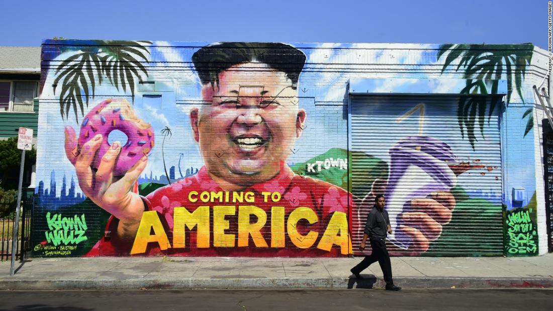 A pedestrian walks past a mural in Los Angeles that depicts North Korean leader Kim Jong Un on Monday, May 14 The mural is in the city's Koreatown neighborhood, and it was created by graffiti artists @welinoo, @balstroem and @sorenarildsen as part of the Ktown Wallz Project.
