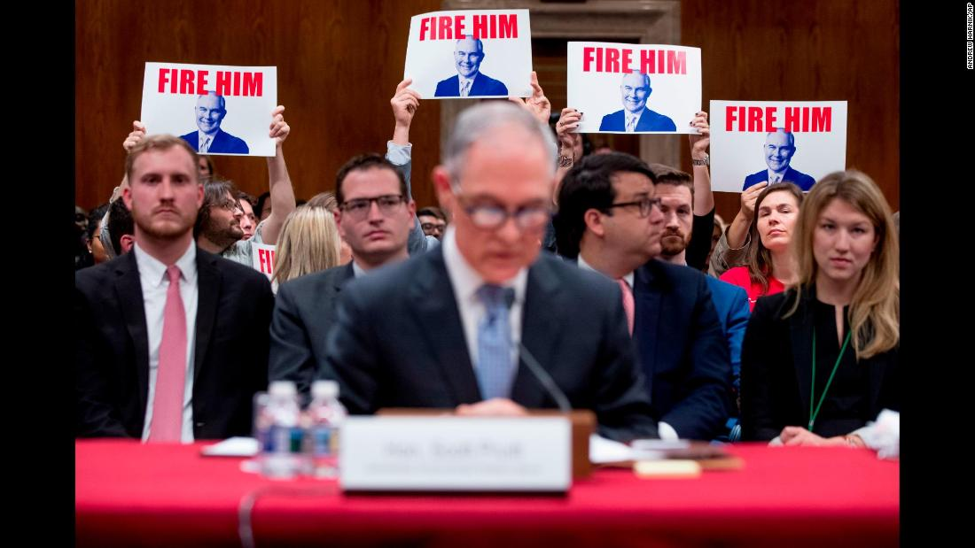 "Members of the audience hold up signs as Scott Pruitt, the embattled administrator of the Environmental Protection Agency, <a href=""https://www.cnn.com/2018/05/16/politics/scott-pruitt-hearing-senate/index.html"" target=""_blank"">testifies before a Senate Appropriations subcommittee</a> on Wednesday, May 16. Pruitt vehemently defended himself while facing tough questions about his spending and alleged ethical transgressions. He said there were some decisions during his tenure he would not have made again with the benefit of hindsight, but he also denied some of the allegations against him and said some were exaggeration."