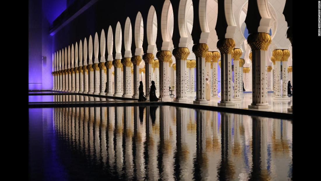 People walk Wednesday, May 16, at the Sheikh Zayed Grand Mosque in Abu Dhabi, United Arab Emirates. Ramadan, the Islamic holy month of fasting, began at sundown on Tuesday.
