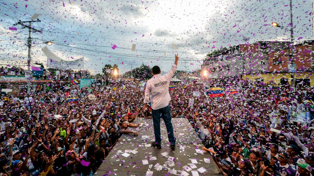"Presidential candidate Javier Bertucci waves to supporters during a campaign rally in Valencia, Venezuela, on Wednesday, May 16. <a href=""https://www.cnn.com/2018/05/16/americas/venezuela-election-sunday/index.html"" target=""_blank"">Venezuelans will head to the polls Sunday</a> to elect a president. The incumbent, Nicolas Maduro, assumed office when Hugo Chavez died in 2013."