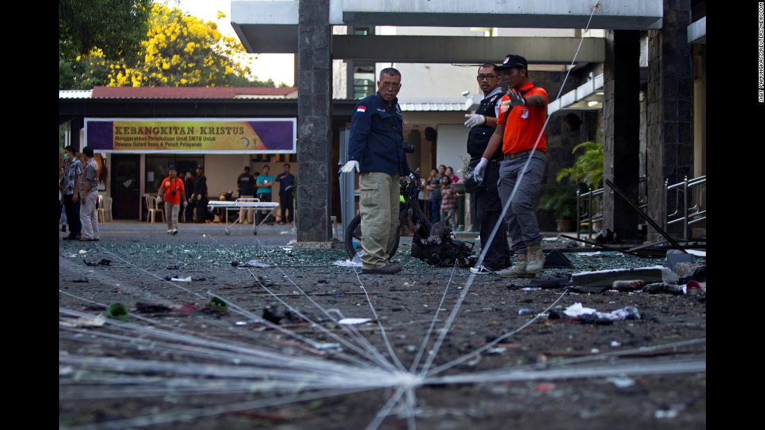"A forensics team examines the scene of a church bombing in Surabaya, Indonesia, on Sunday, May 13. A husband and wife used their four children in a string of <a href=""https://www.cnn.com/2018/05/13/asia/indonesia-church-attacks-surabaya/index.html"" target=""_blank"">deadly suicide attacks on three churches,</a> according to the country's ranking police official."