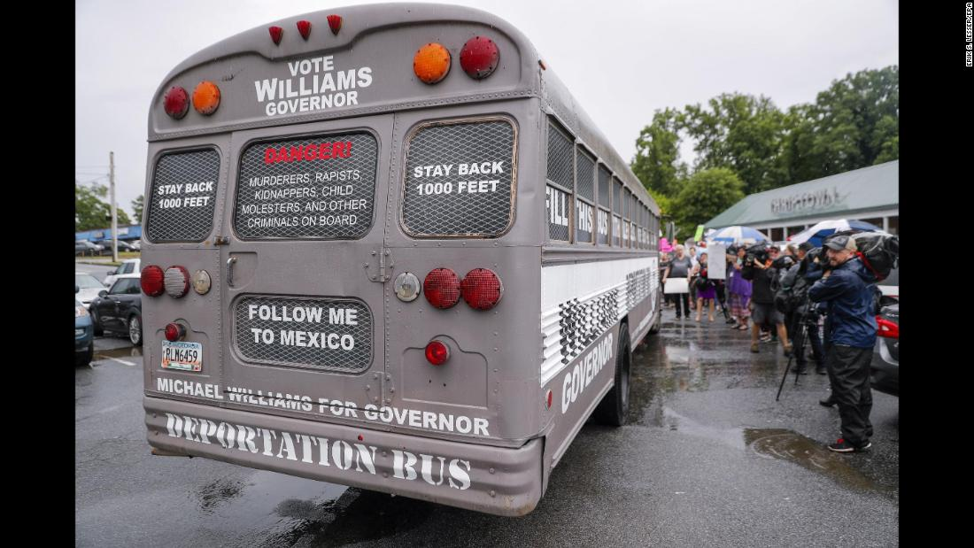 "Protesters surround the ""Deportation Bus"" of Michael Williams, a Republican gubernatorial candidate, during a stop in Clarkston, Georgia, on Wednesday, May 16. Williams says <a href=""https://www.cnn.com/2018/05/15/politics/georgia-governor-candidates-deportation-bus-trnd/index.html"" target=""_blank"">the bus</a> is a show of support for the Trump administration's crackdown on illegal immigration."