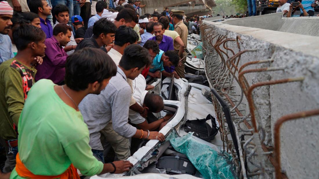"People look for survivors inside vehicles that were crushed when <a href=""https://www.cnn.com/2018/05/16/asia/india-overpass-collapse-varanasi-15-dead-intl/index.html"" target=""_blank"">a section of a partially constructed overpass collapsed </a>in Varanasi, India, on Tuesday, May 15. At least 15 people were killed."