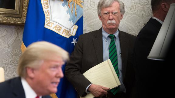 National Security Adviser John Bolton stands alongside US President Donald Trump as he speaks during a meeting with NATO Secretary General Jens Stoltenberg in the Oval Office of the White House in Washington, DC, May 17, 2018. (Photo by SAUL LOEB / AFP)        (Photo credit should read SAUL LOEB/AFP/Getty Images)