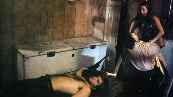 """""""The Texas Chainsaw Massacre"""" -- Dinner time was never more dastardly than in Tobe Hooper's 1974 cannibal classic. Leatherface and co.'s twisted family dynamic has been interpreted as a metaphor for capitalism, post-industrial America and pro-vegetarian propaganda. You'll never invite granddad to supper again."""