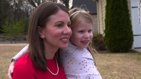Stacey Evans, pictured with her daughter, says she can win support from moderates and disillusioned Republicans.