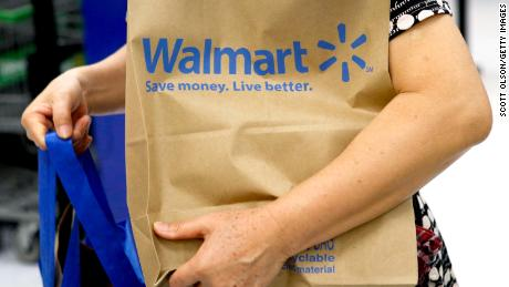 CHICAGO, IL - AUGUST 15: The Walmart logo is displayed on a shopping cart at a Walmart store on August 15, 2013 in Chicago, Illinois. Walmart, the world's largest retailer, reported a surprise decline in second-quarter same-store sales today. The retailer also cut its revenue and profit forecasts for the fiscal year.  (Photo by Scott Olson/Getty Images)