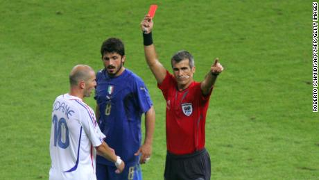 Berlin, GERMANY:  French midfielder Zinedine Zidane (L) receives a red card from referee Horacio Elizondo of Argentina (R) for apparently head-butting Italian defender Marco Materazzi (not pictured) as Italian midfielder Gennaro Gattuso (C) looks on during the World Cup 2006 final football match between Italy and France at Berlin's Olympic Stadium, 09 July 2006.  Italy went on to win 5-4 in a penalty shootout after the teams finished in extra time 1-1.    AFP PHOTO / ROBERTO SCHMIDT  (Photo credit should read ROBERTO SCHMIDT/AFP/Getty Images)