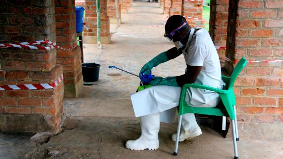 In this photo taken on Sunday, May 13, 2018, a health care worker wears virus protective gear at a treatment center in Bikoro Democratic Republic of Congo. Congo