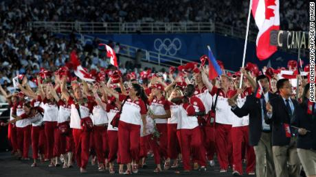 Flagbearer Nicolas Gill leads out the Canadian contingent at the Athens 2004 Olympic Opening Ceremony.