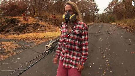 Steve Gebbie walks the streets of Leilani Estates, a community hard hit after Hawaii's Kilauea volcano erupted May 3.
