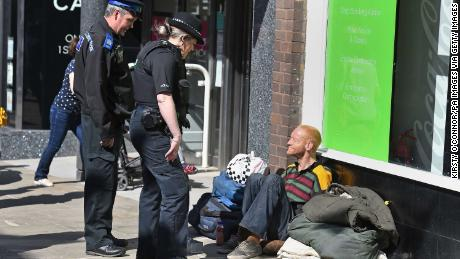 A police officer talks to a homeless man in Windsor on May 17, 2018, two days before the royal wedding.