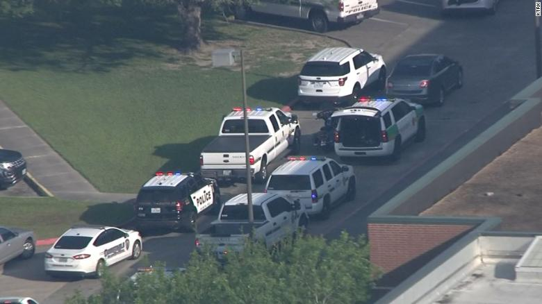 Authorities respond to a report of a shooting at Santa Fe High School Friday.