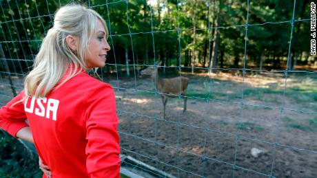 Rhonda Faehn, USA Gymnastics Senior Vice President of Women's Program, looks at the deer during a tour of the Karolyi Ranch Saturday, Sept. 12, 2015, in New Waverly, Texas. (AP Photo/David J. Phillip)